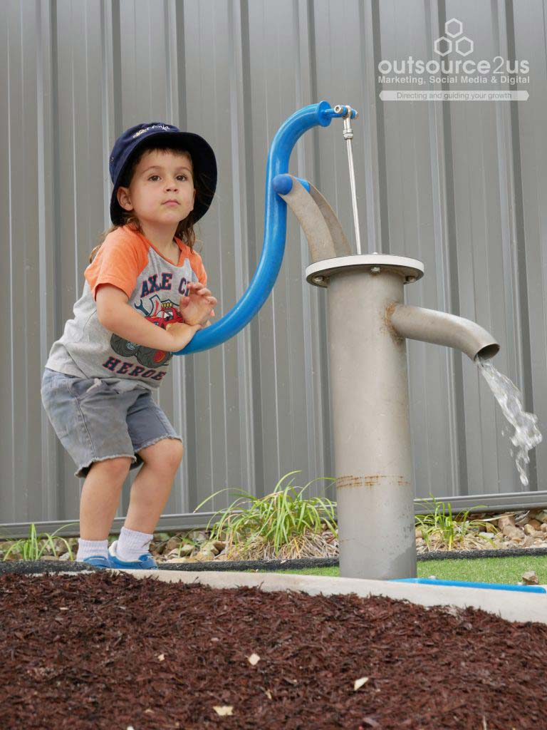 Little boy pumping water - Outsource To Us