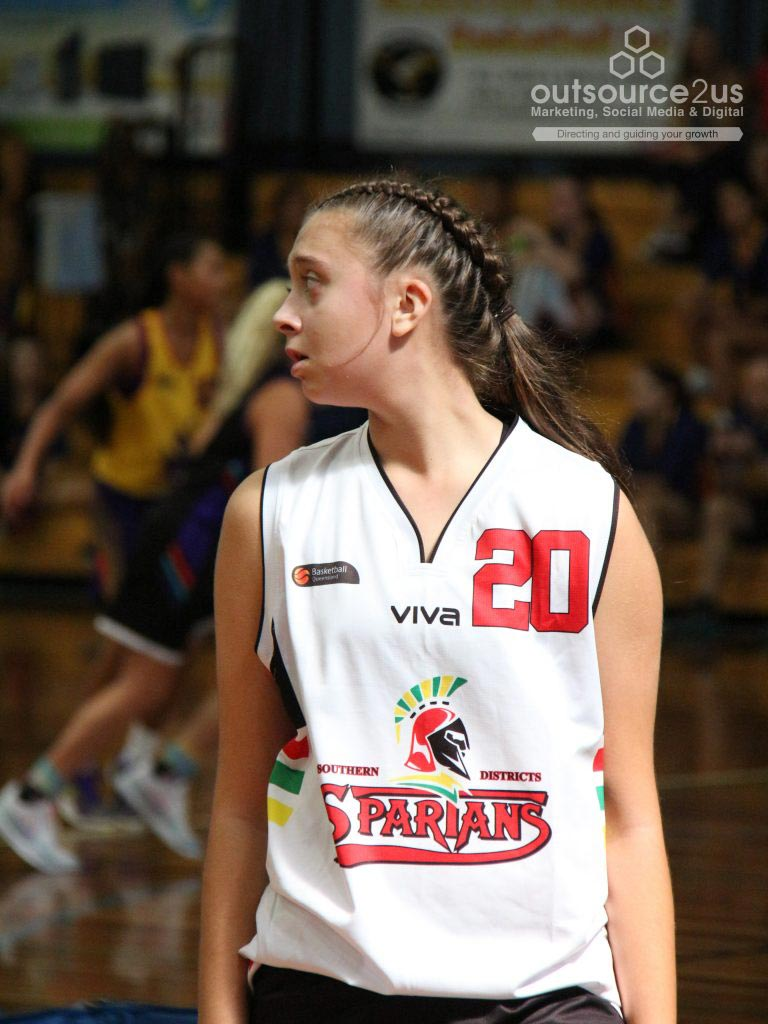 Girl basketball player wearing white Spartans jersey - Outsource To Us